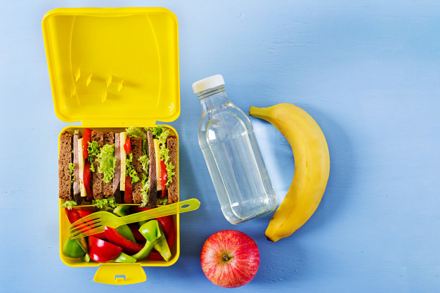 healthy-school-lunch-box-with-beef-sandwich-fresh-vegetables-bottle-water-fruits_2829-5924